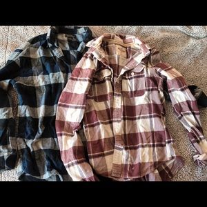 Two plaid men flannel tops